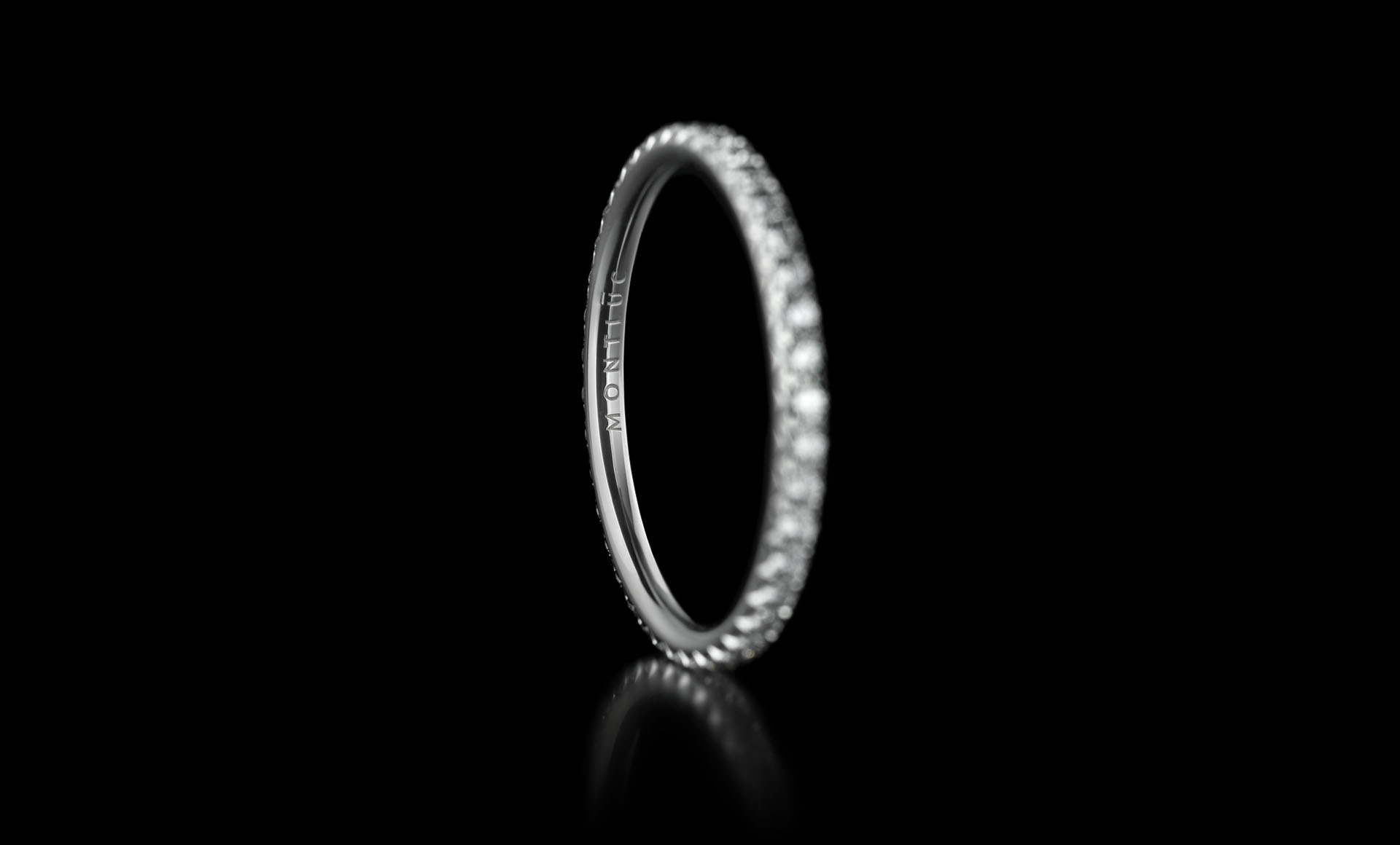 Montluc - Halo No.1 diamond ring, viewed from an angle, with engravement in focus
