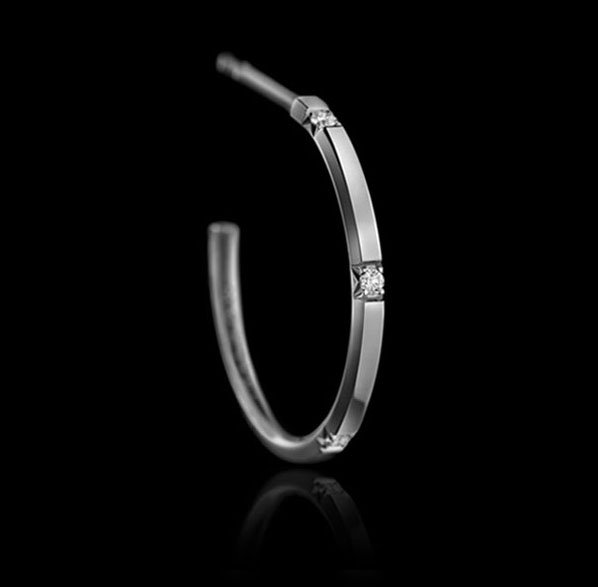 Montluc -Halo No 4. Diamond hoop earrings, each one set with 5 perfect, brilliant cut diamonds