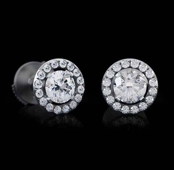"Montluc - Orbit No 2 diamond stud earrings , a triple excellent central diamond surrounded by an ""orbit"" of perfect round cut small diamonds."