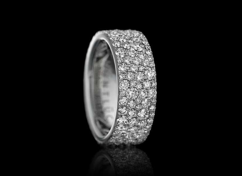 "Montluc - Constellation No 1. Diamond ring ""serti neige"": in this stunning band, diamonds are set playing on variations in diameter to completely cover the metal and to create a beautiful effect of organized chaos."