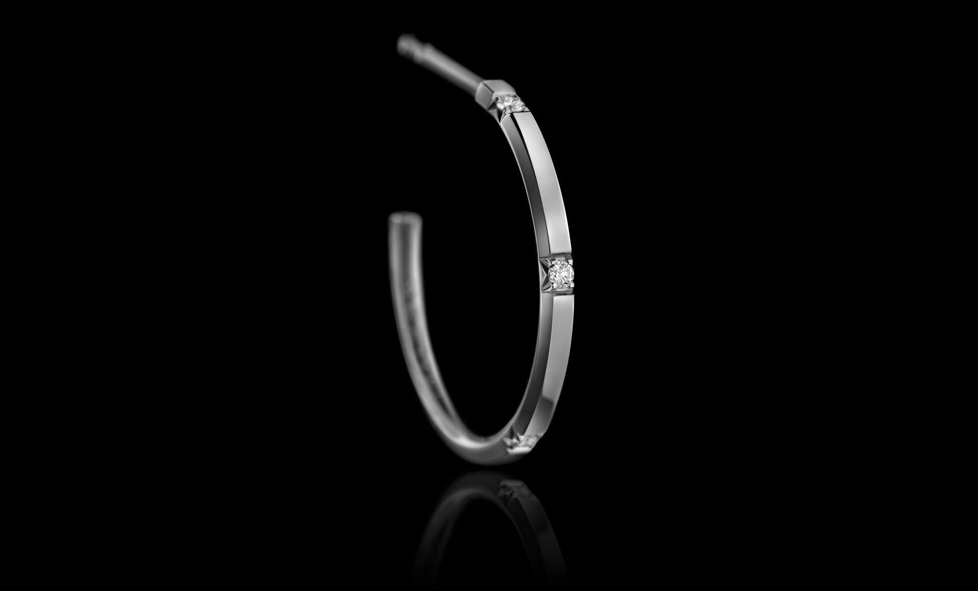 Montluc - Halo No 4. Diamond hoop earrings, each one set with 5 perfect, round cut diamonds.