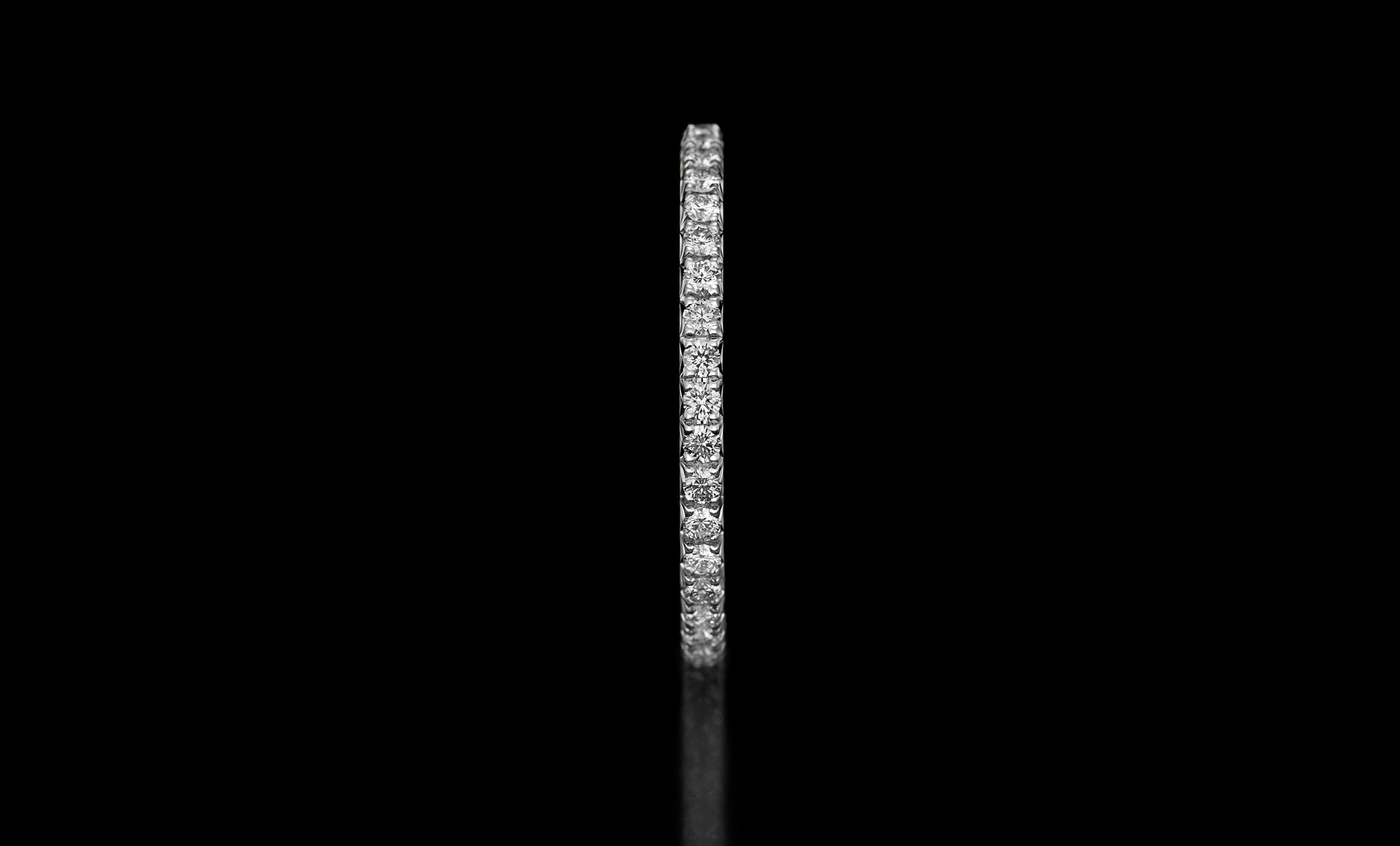 Montluc - Halo No 1 diamond ring, viewed from the side.