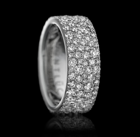 "Montluc - Constellation No 1. Diamond ring ""serti neige"": in this stunning band, diamonds are set playing on variations in diameter to completely cover the metal and to create a beautiful effect of organised chaos."