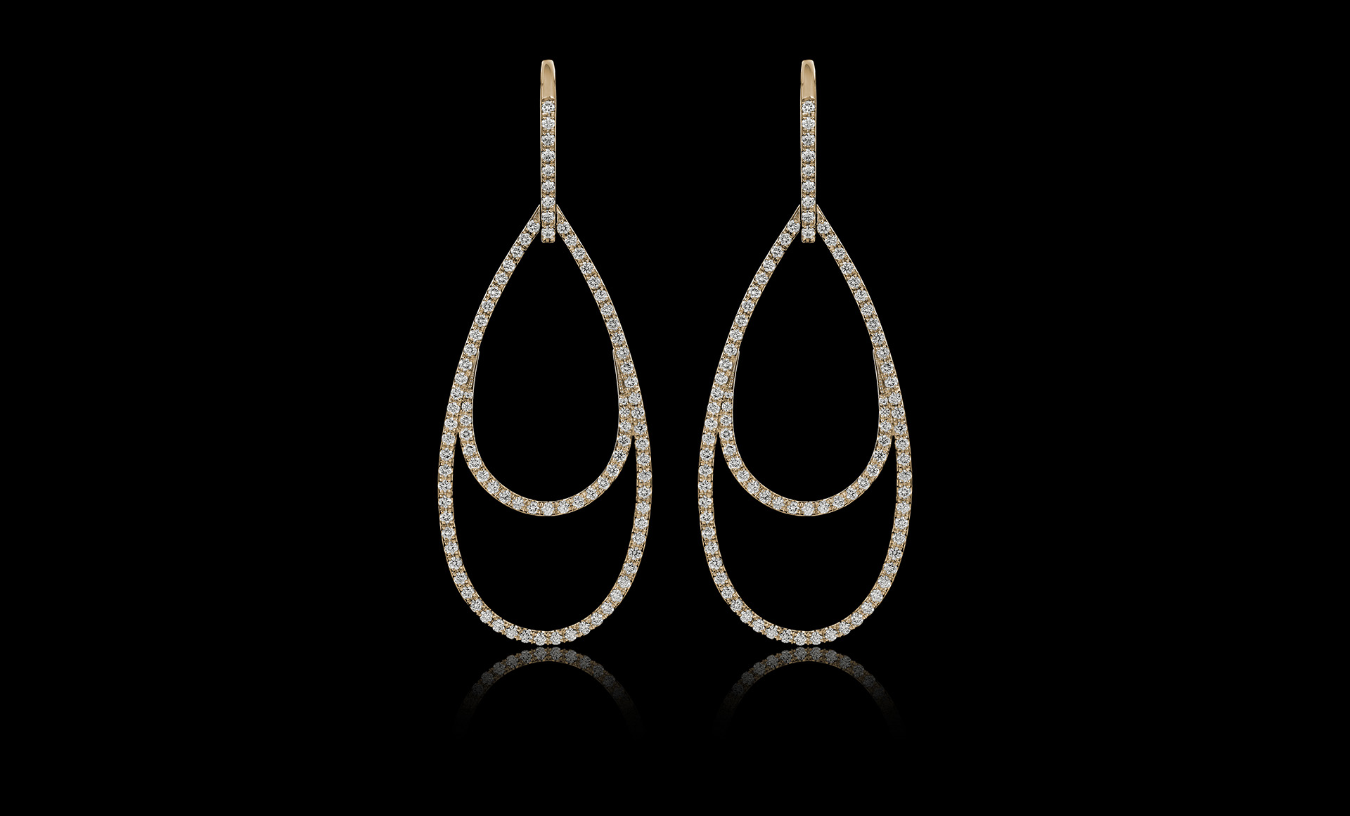 Montluc - Ellipse No.1, a raindrop-shaped diamond earring.